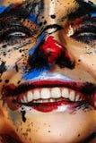 Glimlachende krankzinnige Clown Woman met witte Ogen royalty-vrije stock foto