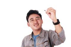 Glimlachende Mannelijke Aziatische Student Writing royalty-vrije stock foto's