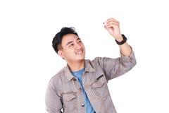 Glimlachende Mannelijke Aziatische Student Writing stock fotografie