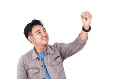 Glimlachende Mannelijke Aziatische Student Writing stock afbeelding