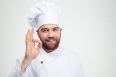 Glimlachende mannelijke chef-kokkok die o.k. teken tonen Royalty-vrije Stock Foto