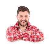 Glimlachende mens in de helling van het houthakkersoverhemd op een banner royalty-vrije stock afbeelding