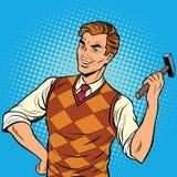Glimlachende mens met een hamer, huisreparaties Royalty-vrije Stock Afbeelding