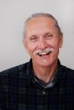 Glimlachende mens op middelbare leeftijd op witte achtergrond Royalty-vrije Stock Fotografie