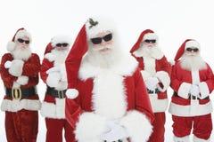 Glimlachende Mensen in Santa Claus Outfits stock foto