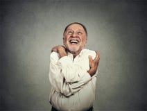 Glimlachende mensenholding die koesteren royalty-vrije stock foto's