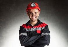 Glimlachende mijnwerker stock afbeeldingen