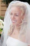 Glimlachende mooie bruid Stock Afbeelding