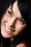 Glimlachende mooie vrouw Royalty-vrije Stock Afbeeldingen