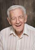 Glimlachende oude mens Stock Foto