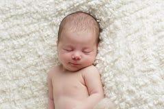 Glimlachende pasgeboren baby Royalty-vrije Stock Afbeelding