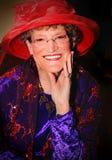 Glimlachende Red Hat-Dame stock afbeeldingen