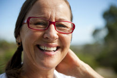 Glimlachende rijpe vrouw. Stock Afbeelding