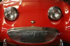Glimlachende rode auto Royalty-vrije Stock Foto's