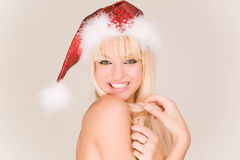 Glimlachende sexy Mevr. Kerstman stock foto