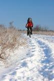 Glimlachende sneeuwfietser Stock Afbeelding