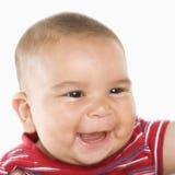 Glimlachende Spaanse mannelijke baby. stock foto