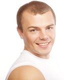 Glimlachende spier Kaukasische mens stock foto's