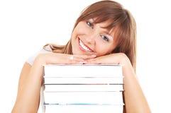 Glimlachende student met boeken Royalty-vrije Stock Afbeeldingen