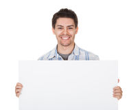 Glimlachende toevallige mens met leeg teken Royalty-vrije Stock Fotografie