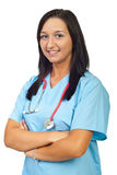 Glimlachende verpleegster met gevouwen wapens Stock Foto's