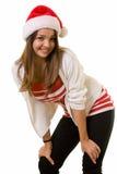 Glimlachende vrouw in de hoed van de Kerstman Stock Foto's