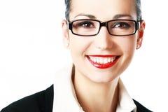 Glimlachende vrouw die glazen draagt Stock Foto's
