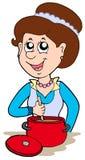 Glimlachende vrouw die thuis kookt Stock Afbeelding