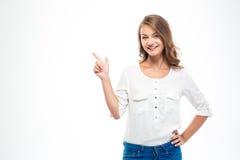 Glimlachende vrouw die vinger weg richten stock afbeeldingen