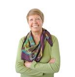 Glimlachende vrouw in groen Stock Fotografie