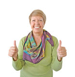 Glimlachende vrouw in groene tonende duim omhoog Stock Foto