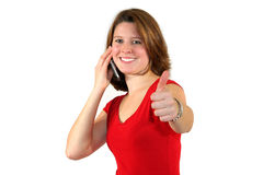 Glimlachende vrouw met cel omhoog telefoon en duimen Royalty-vrije Stock Foto