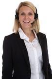 Glimlachende vrouw met de secretaresse van het het telefoongesprekcentrum van de hoofdtelefoontelefoon Stock Afbeeldingen