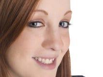 Glimlachende vrouwenclose-up Stock Foto's