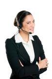 Glimlachende vrouwenexploitant met hoofdtelefoon Stock Foto's
