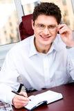 Glimlachende werkgever stock afbeelding
