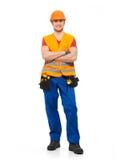 Glimlachende werkman met hulpmiddelen in eenvormig stock afbeelding