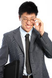 Glimlachende zakenman die glazen dragen Royalty-vrije Stock Fotografie
