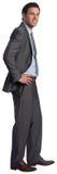 Glimlachende zakenman met handen op heupen stock afbeelding