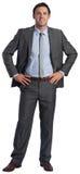 Glimlachende zakenman met handen op heupen stock foto's