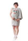 Glimlachende zwangere vrouw stock afbeelding
