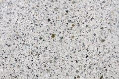 Glimma granitstruktur för vit på en arbetad sten arkivfoton