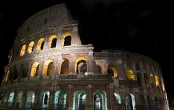 Glimpse of the Colosseum at night, in Rome stock photo
