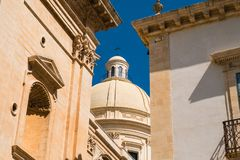 A glimpse of the late baroque architecture in Noto, Italy. Realized in a typical local stone Royalty Free Stock Photo