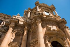 A glimpse of the late baroque architecture in Noto, Italy. Realized in a typical local stone Stock Photo