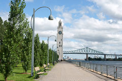 Glimpse of Montreal. Montreal clock tower located at the entrance of the old port of the city. Also called Victoria Pier or Sailors Memorial Clock, the clock Stock Photography