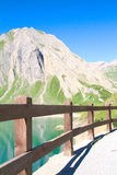 Glimpse of Morasco lake, formazza lake. View of path along morasco lake, formazza valley Royalty Free Stock Image