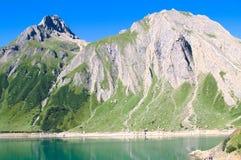 Glimpse of Morasco lake, formazza lake. View of path along morasco lake, formazza valley Stock Photo
