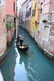Characteristic view with gondola sailing on a narrow canal of Venice royalty free stock photo