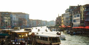 Traffic of boats in a typical canal in Venice city stock photo